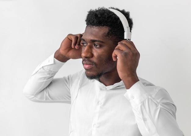 African american man using headphones and looking away