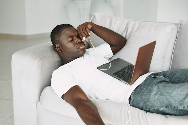 African american man watching a movie on the laptop