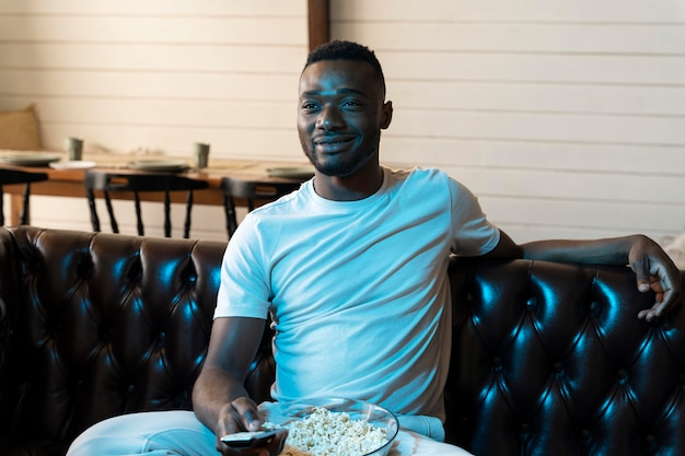 African american man watching a movie on netflix