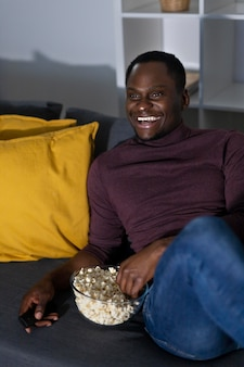 African american man watching netflix at home