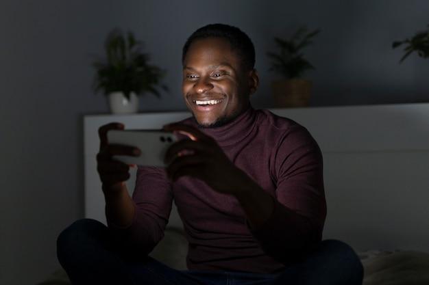 African american man watching netflix indoors