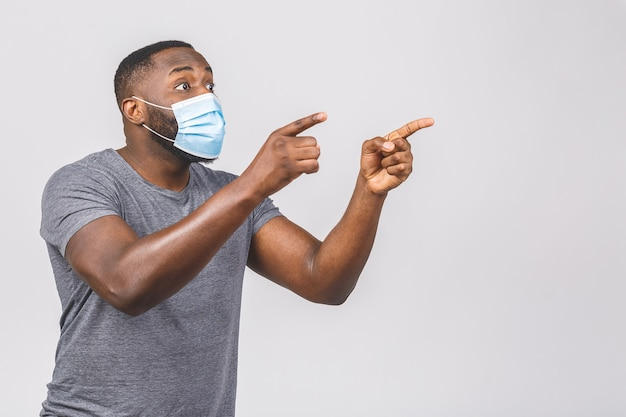 African american man wearing hygienic mask to prevent infection, airborne respiratory illness