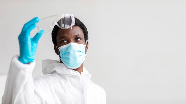 African american man wearing protective equipment with copy space