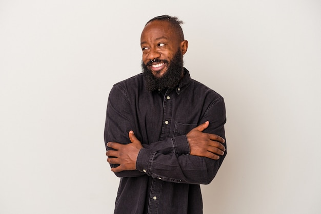 African american man with beard isolated on pink background smiling confident with crossed arms.