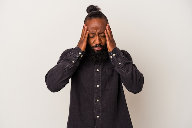 African american man with beard isolated on pink background touching temples and having headache.