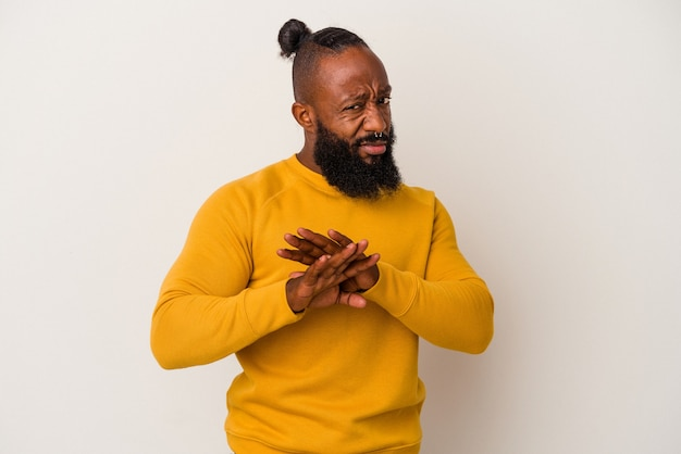 African american man with beard isolated on pink wall doing a denial gesture