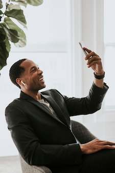 African american man with earphones video calling