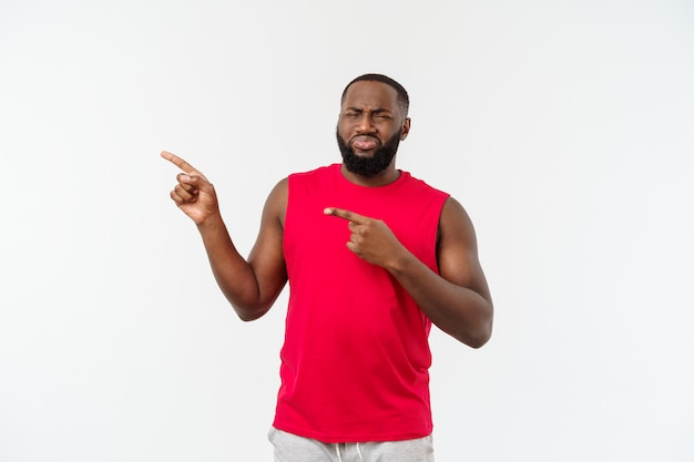 African-american man with sport wear pointing fingers with unhappy emotion.
