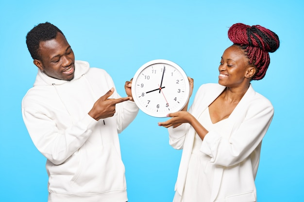 African american man and woman posing on color spaces