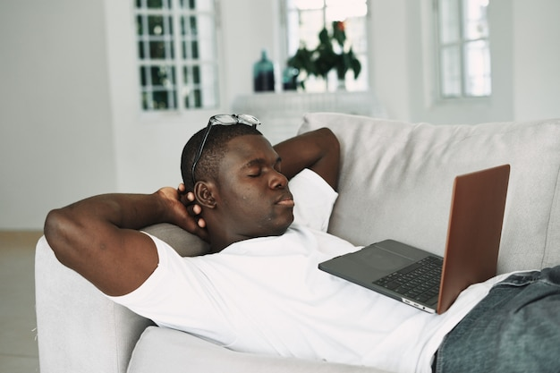 African american man working at home freelancer laptop