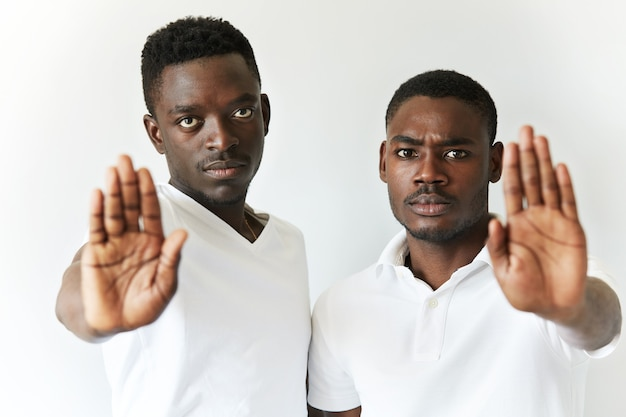 African american men in white t-shirts