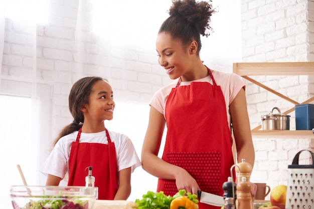 African american mother and daughter preparing