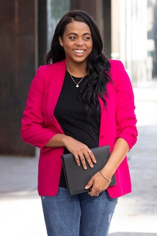 African american oman in pink blazer stylish business casual look