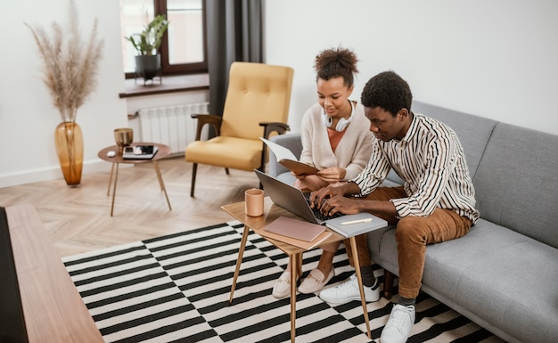 African american people working from a modern place