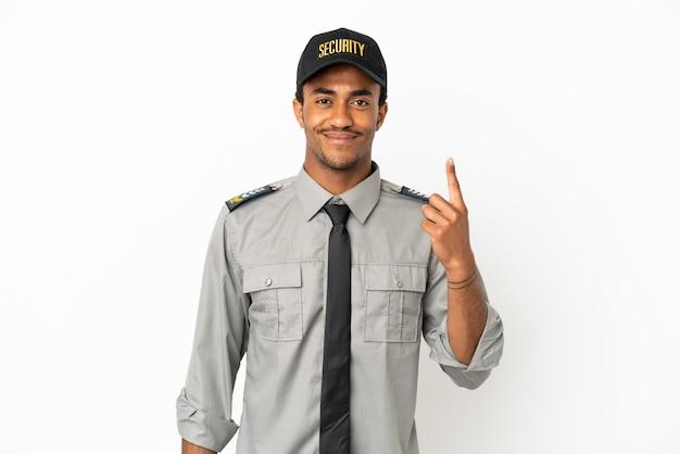 Афро-американская охрана на изолированном белом фоне, указывая указательным пальцем - отличная идея Premium Фотографии