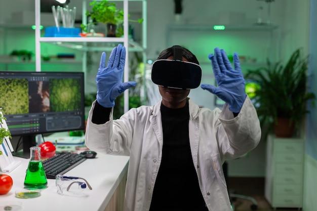 African american scientist woman wearing virtual reality headphones