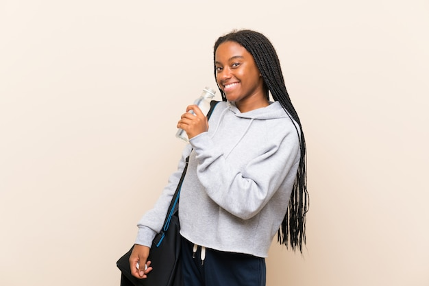 African american sport teenager girl with long braided hair