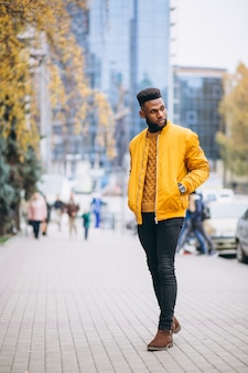 African american student walking in the street