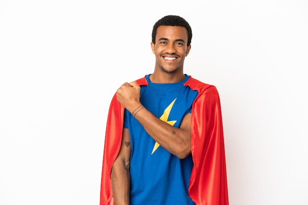 African american super hero man over isolated white background celebrating a victory
