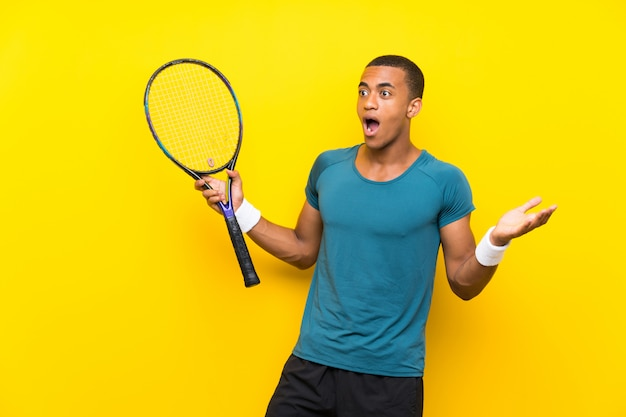 African american tennis player man with surprise facial expression