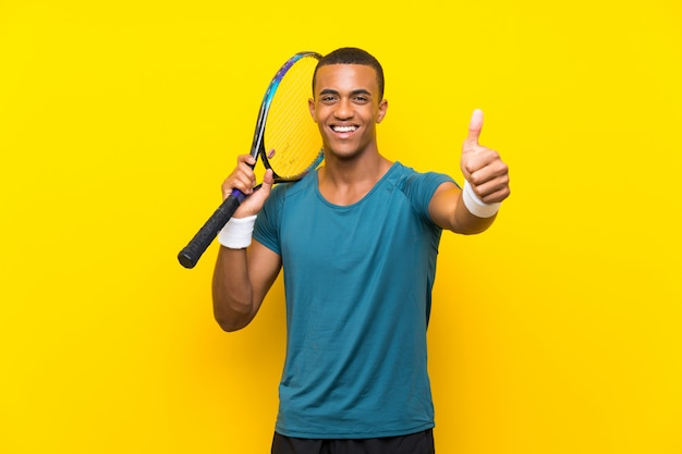 African american tennis player man with thumbs up because something good has happened