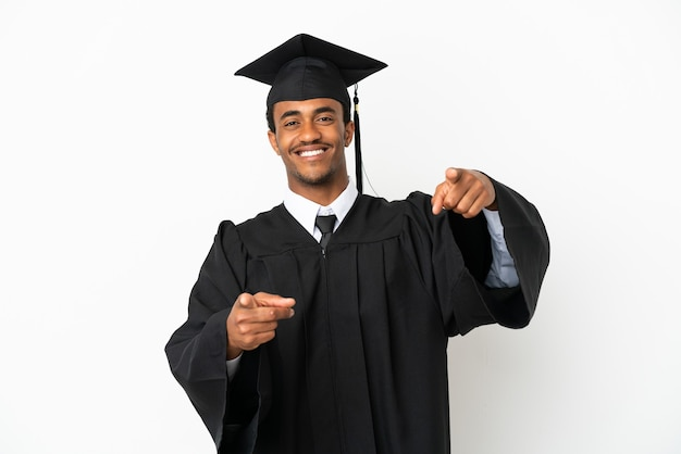 African american university graduate man over isolated white background points finger at you while smiling