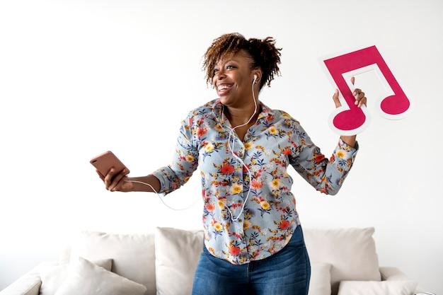 African american woman enjoying music