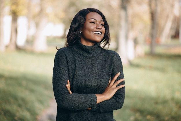 African american woman happy outside in park