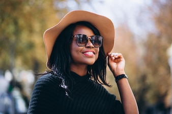 African american woman in autumn outdoors