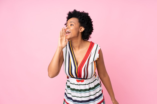African american woman isolated shouting with mouth wide open to the lateral