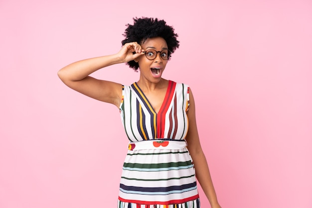 African american woman isolated with glasses and surprised