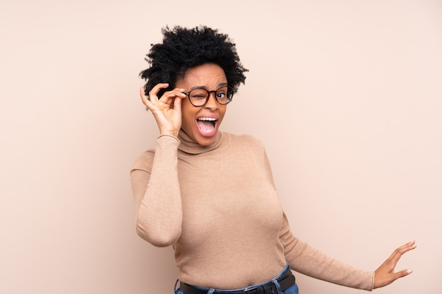 African american woman isolated with glasses surprised