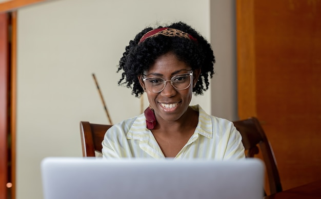 African american woman looking at laptop screen
