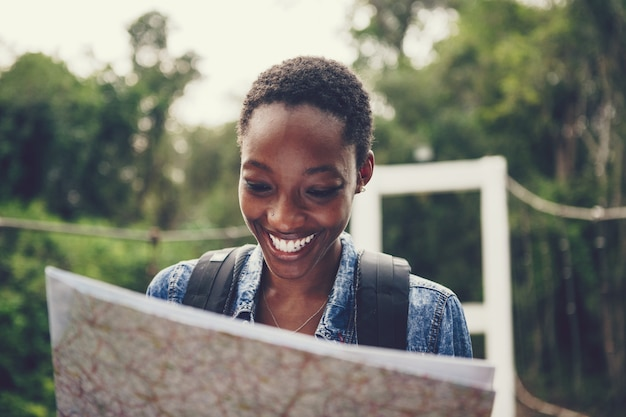 African american woman looking at a map
