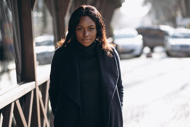 African american woman model in coat in the street