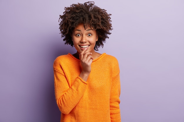 African american woman in orange jumper