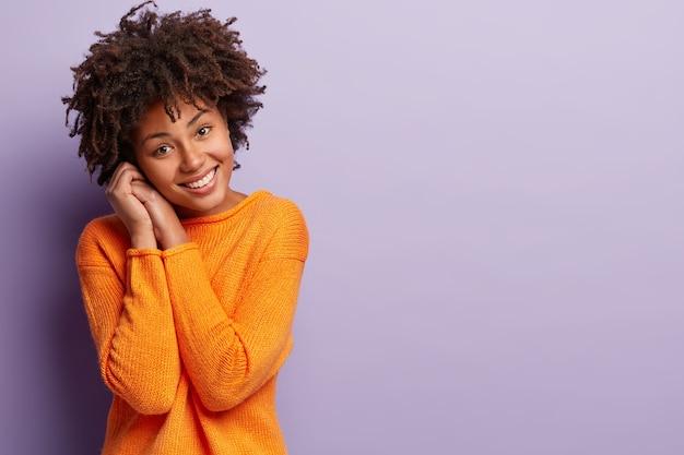African american woman in orange jumper