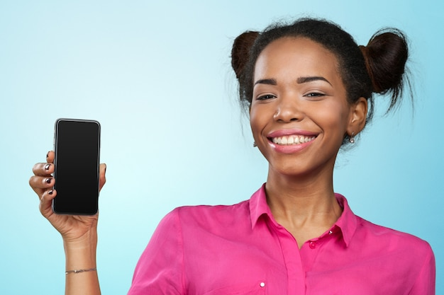 African american woman showing a mobile phone