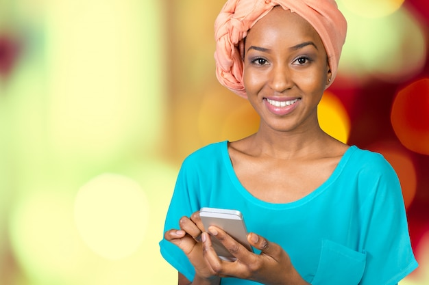 African american woman talking and texting
