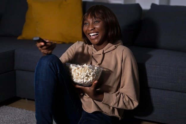 African american woman watching netflix at home