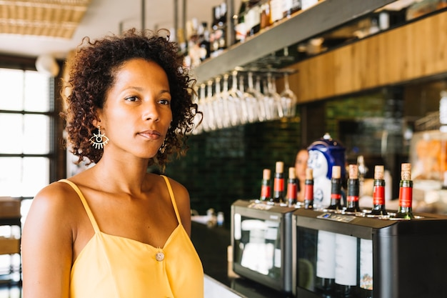 An african-american young woman at bar counter