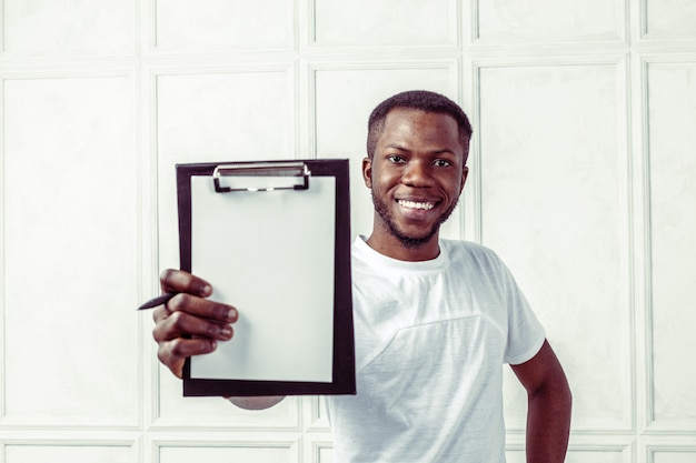 African business man with a clipboard