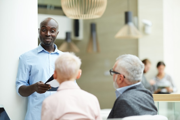 African businessmanleading training seminar