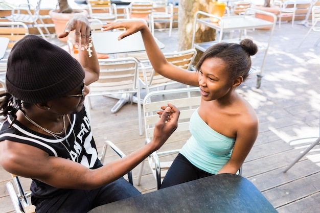 African couple having fun in cafe