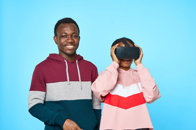 African couple using vr glasses