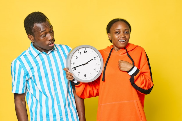 African couple with clock