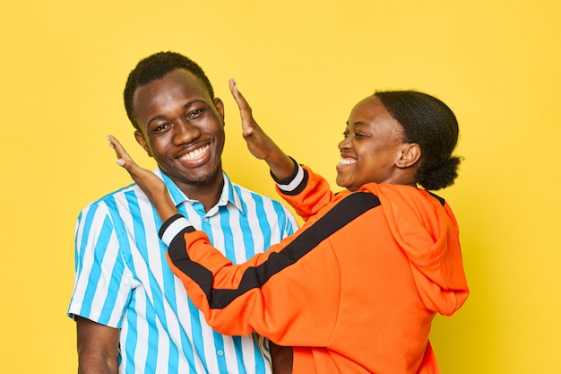 African couple on yellow