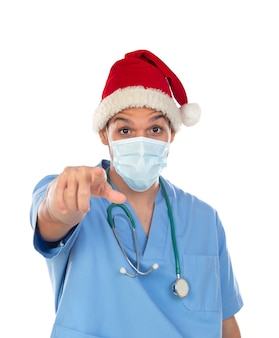 African doctor wearing a christmas hat at coronavirus time isolated on a white background