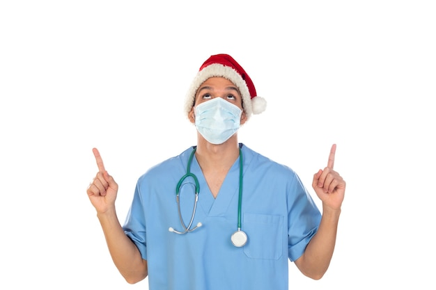 African doctor wearing a christmas hat at coronavirus time isolated on a white wall