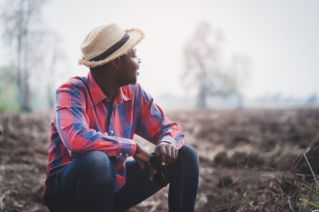 African farmer looking and preparing the soil for planting.agriculture or cultivation concept